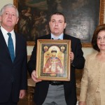 HRH Crown Prince Alexander II, Mr Igor Smikov, advisor to the Primate of the Russian Orthodox Church Abroad Metropolitan Hilarion of Eastern America and New York and the head of the Military Orthodox Mission who holds Miraculous Icon of St. Tsar Nicholas and HRH Crown Princess Katherine