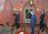 """Crown Prince Alexander, the Prince of Wales and Hereditary Prince Peter in the """"room of whispers"""" in the basement of the Royal Palace"""