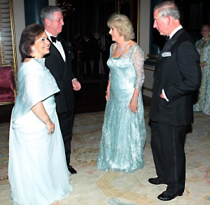 CORRECTS NAMES - The Prince of Wales and the Duchess of Cornwall greet the Crown Prince and Princess of Yugoslavia as they arrive for a dinner at Buckingham Palace, London, for foreign sovereigns to commemorate the Diamond Jubilee. Friday May 18, 2012. (AP Photo/Sean Dempsey, Pool)
