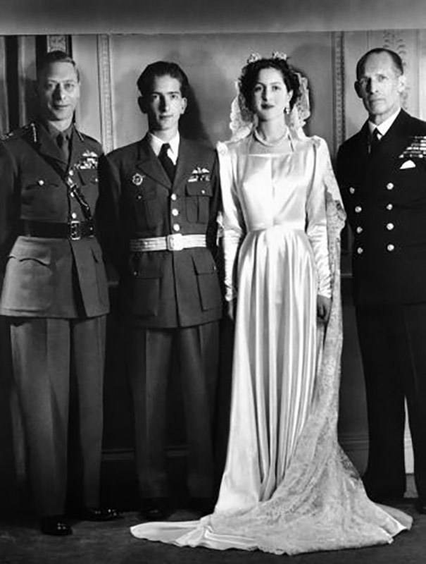 The wedding of HM King Peter II and HRH Princess Alexandra of Greece and Denmark, London, 20 March 1944. To the left of the newlyweds King George VI of Great Britain, to the right King George II of the Hellenes