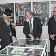Mr Dragomir Acovic, Chairman of the Crown Cuncil, shows exibition to His Royal Highness Prince Mihailo and His Grace Bishop Jovan of Sumadija