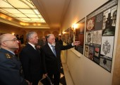 HRH Crown Prince Alexander and Mr. Dragomir Acovic watching the exhibition