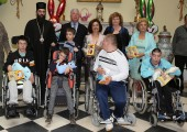 His Grace Arsenije, Bishop of Toplica, Their Royal Hignesses Crown Prince Alexander and Crown Princess Katherine, HE Ms. Patricia Feeney, ambassador of Australia and Ms. Betti Roumeliotis with children with disabilities at the Easter receptions