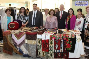 Their Royal Highnesses Crown Prince Alexander and Crown Princess Katherine with Dr. Hon, Dr. Hon's spouse and the exhibitors at the Easter Bazaar