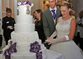 Newlyweds cut the wedding cake
