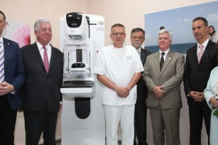 Their Royal Highnesses Crown Prince Alexander and Crown Princess Katherine and HE Mr. Kyle Scott, Ambassador of United States of America next to new mammography in a visit to the Clinical center Nis
