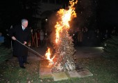 HRH Crown Prince Alexander while burning the yule log in front of the Royal palace