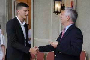 HRH Crown Prince Alexander gives a commendation