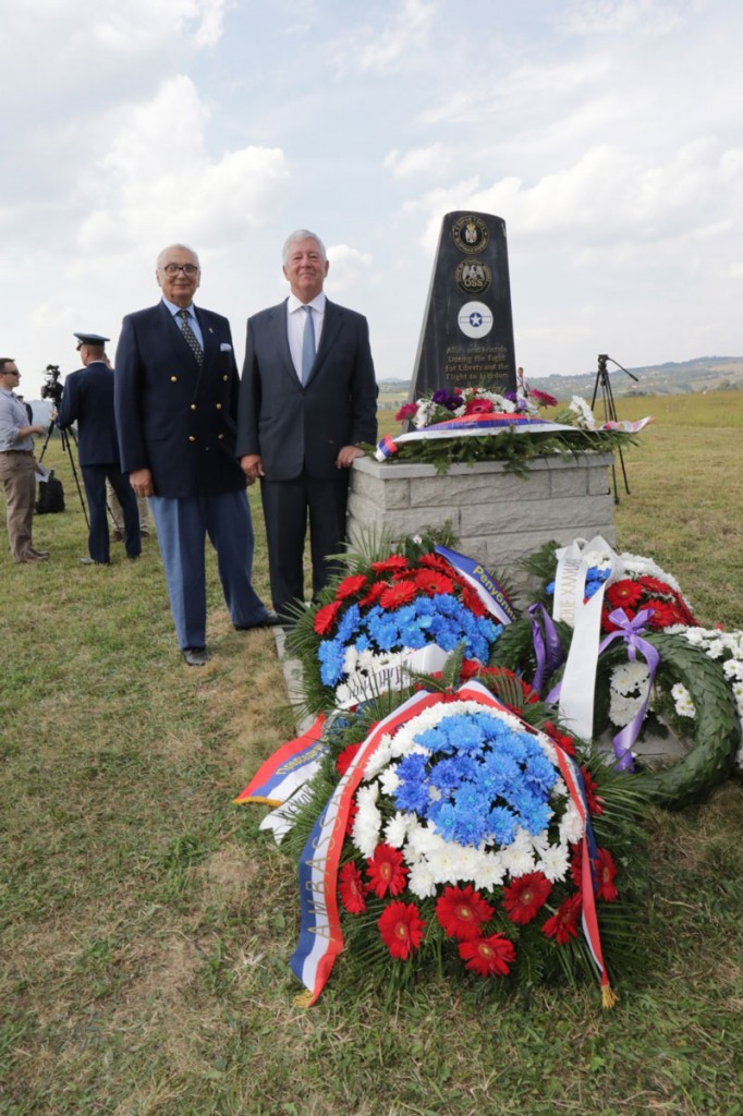 HRH Crown Prince Alexander and Mr Branko Terzic, Privy Council, next to the monument honouring the Halyard Mission at Galovica Field
