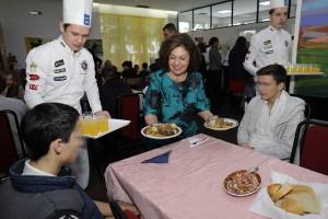 "HRH Crown Princess Katherine serves the lunch for children in ""Jovan Jovanovic Zmaj"" home"